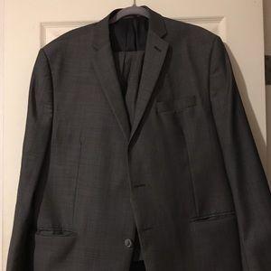 Grey 2 piece suit. Pants is sized 40W x 32L